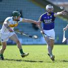Jack Goulding of Kerry and Paddy Rigney of Offaly in action at Austin Stack Park, Tralee. Photo: Domnick Walsh