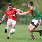 Darren Brosnan, East Kerry clears the ball despite the challenge of Colin McGillicuddy, Mid Kerry in the Kerry County Garvey Supervalu Senior Football Championship Round 2B at Lewis Road, Killarney on Sunday. Photo by Michelle Cooper Galvin