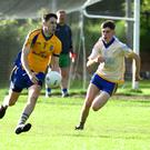 Gerard Hartnett, Beaufort, clears his line as Spa's Niall McCarthy closes in during their County SFL Division 2 meeting at Spa on Friday. Photo by Michelle Cooper Galvin