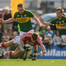 Cork's Ian Maguire is fouled for a penalty by Peter Crowley in their April 2016 Allianz Football League Division 1 meeting Austin Stack Park, Tralee - the last time the counties met in either League or Championship