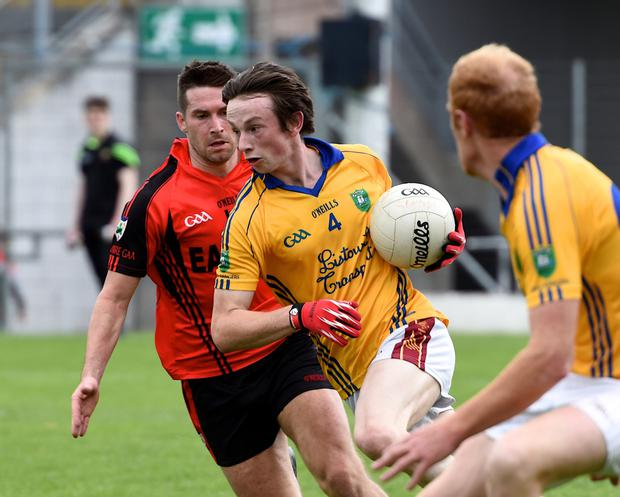 Aaron O'Connor, Feale Rangers, clearing his defence is chased by Paul O'Connor, Kenmare Shamrocks, in the County Senior Football Championship Round 3 at Fitzgerald Stadium, Killarney on Sunday. Photo by Michelle Cooper Galvin
