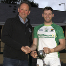Johnny Stack Chairman North Kerry Football Board presenting the McCarthy Insurance Listowel sponsored North Kerry League Division 1 cup to Paul Kennelly Ballydonoghue after they defeated Desmonds in the final on Saturday evening in Listowel. Photo by John Stack