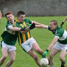 Lispole's Garreth Noonan is tackled by Cian Bradley, Listry, in their County JFC semi-final in Strand Road. Photo by Domnick Walsh