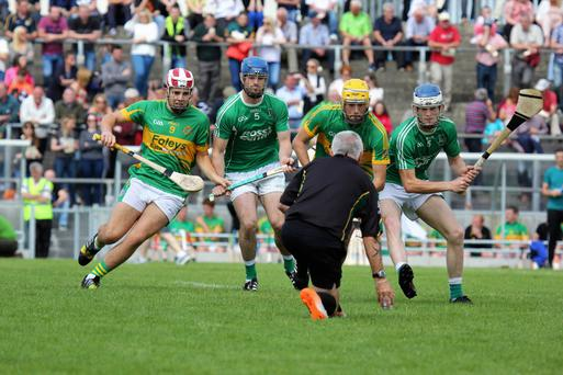 Referee Dave Coops throws the ball in for Ballyduff and Lixnaw during their second round contest in the County SHC. The pair face off again in Sunday's final. Photo by Eye Focus