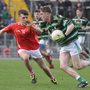 St Brendans' Jason Mortimer, in possession of the ball, looks to get past East Kerry's Darragh Looney