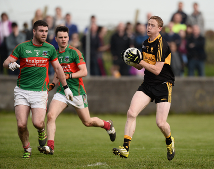 Colm Cooper in action against Darren Hickey of Kilmurry-Ibrickane during last year's Munster Club SFC quarter-final in Quilty, Co. Clare. Hickey is almost certain to start for the Clare champions next Sunday but the question is if Cooper will start for Dr Crokes or be held among the substitutes as he was for the Munster quarter-final against Clonmel Commerials