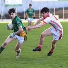 Patrick D'Arcy, St Brendan's College, gets away from Geared Ó Leidhim, Pobalscoil Chorca Dhuibhne, in their Corn Uí Mhuiri semi-final at Fitzgerald Stadium. Photo by Michelle Cooper Galvin
