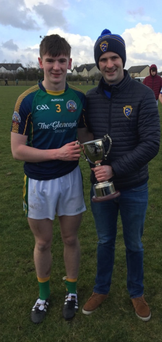 St Brendan's College team captain Kieran O'Donoghue receiving the Frewen Cup from Munster Post-Primary Servicing Officer John Brennan