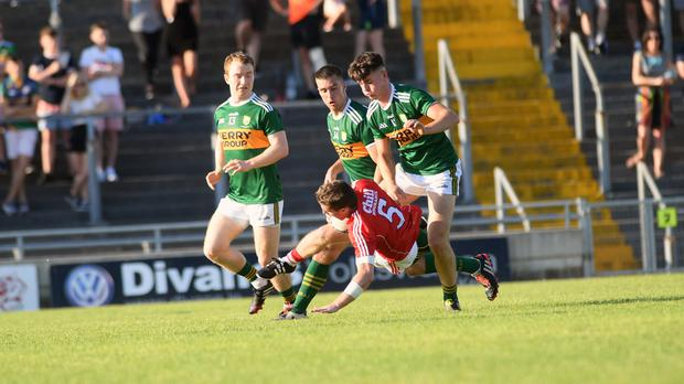 Cork defender Kevin Cremin comes under pressure from, from left, Thomas Hickey, Dan Daly and Lee Donoghue in the Munster Junior Football Championship Final in Austin Stack Park, Tralee