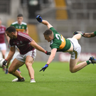 Jason Foley goes airborne as he tries to tackle Damien Comer during Sunday's All-Ireland SFC quarter-final Group 1 Phase 1 match at Croke Park. Photo by Sportsfile