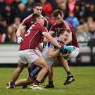 Monaghan's Jack McCarron is tackled by Cathal Sweeney, Eamonn Brannigan and Paul Conroy of Galway during their NFL meeting at Pearse Stadium in Galway back in March. Photo by Sportsfile