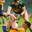 Charlie Carthy of Roscommon in action against Dan McCarthy of Kerry