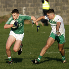 Jack O'Sullivan, Ballyduff on the attack despite the close attention of Darragh Sheehy, Ballydonoghue during the North Kerry Championship semi-final played in Ballybunion on Sunday