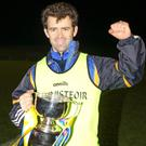 Beaufort manager Eanna O'Malley with the Cup
