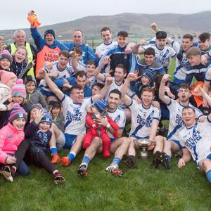 The St Marys team celebrate with supporters after winning the South Kerry SFC title for the fifth year in a row. Photo by Christy Riordan