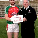 Johnny Brosnan, East Kerry Board Chairman, presenting the Aquila Club Man of the Match award to Kilcummin's Gary O'Leary