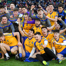 Beaufort players celebrate with the cup after winning the All-Ireland Club Junior Football Championship Final at Croke Park. Photo by Sportsfile