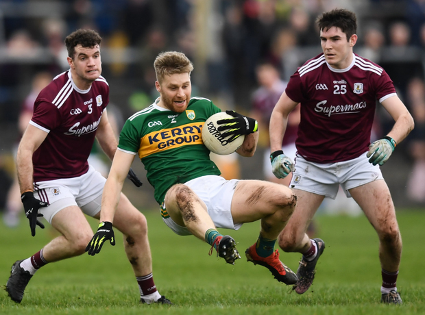 Peter Crowley in action against Johnny Duane, left, and Barry McHugh of Galway. Photo by Sportsfile