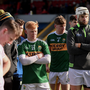 Dejected Kerry players watch as Westmeath collect the cup