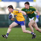 Conor Devanney of Roscommon in action against Kerry's Kevin McCarthy during their 2017 NFL meeting in Dr Hyde Park. Photo by Sportsfile