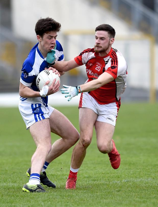 Darragh McElligott, Kerins O'Rahillys, challenged by Rathmore's Brian Moynihan in the Senior Club Championship at Fitzgerald Stadium, Killarney on Sunday. Photo by Michelle Cooper Galvin