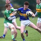 Shane Courtney, Glenflesk under pressure from Alan O'Donoghue of John Mitchels in the Kerry Petroleum Intermediate Club Championship Round 3 at Glenflesk on Sunday afternoon. Photo by Michelle Cooper Galvin