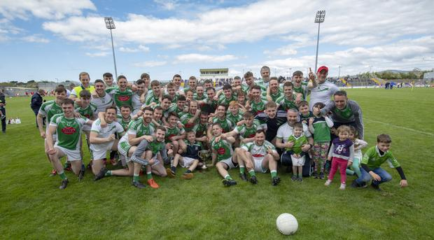 Na Gaeil players, management and supporters celebrate with the Premier Junior cup after winning the county final in Austin Stack Park last Sunday