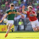 David Clifford of Kerry in action against Ruairi Deane of Cork during the Munster GAA Football Senior Championship Final match last year