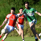 Rathmore's John Moynihan is challenged by Jack O'Neill, Legion, in their County League match at Direen, Killarney on Friday. Photo by Michelle Cooper Galvin