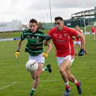 Luke Mulligan, St Brendan's, in action with Mike Foley, East Kerry, in their County SFC Round 1 clash at Austin Stack Park, Tralee. Photo by Joe Hanley