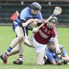 Causeway's Colum Harty with the sliothar against Ballysaggart's Kieran Fennessy and Kieran Bennett during the AIB Munster Club Intermediate Hurling match in Fraher Field. Photo by Seán Byrne