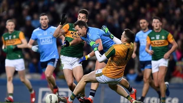 Dean Rock of Dublin is fouled by Kerry's Brian Ó Beaglaoich, left, and goalkeeper Shane Ryan, resulting in a penalty in last week's Allianz NFL Division 1 opener at Croke Park