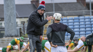 Kerry boss Fintan O'Connor talks to a player before the game in Tralee last Sunday afternoon. Photo by Domnick Walsh / Eye Focus