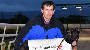 D D O'Rahilly with Realism, the fastest winner of the night, after winning Round 2 heat 8 of the 2021 Lee Strand 550 at the Kingdom Greyhound Stadium on Friday. Photo by www.deniswalshphotography.com