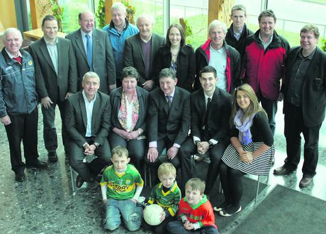 The launch of Comórtas Peile John Egan took place on Saturday last in Tralee. Standing L to R: Johnny Brosnan, Eamon Whelan (Coiste na nÓg Chairman), Johnny Griffin (Kerry County Council), Sean Walsh, Charlie Nelligan, Leona Twiss (Kerry County Committee Cultural Officer),Ger O'Keefe, David O'Leary, Eamonn Egan and Jim O'Sullivan (Sneem GAA chairman). Seated L to r: Ogie Moran, Mary Egan, Ger Galvin (Kerry County Committee Vice Chairman), John Egan and Maureen Egan. With Sean Twiss, Niall and Karol Egan at the front. Picture by Paddy White