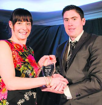 Carmela Morey receiving her award from Joe McGill who ran The Gathering of the Clans in south Kerry at the weekend.