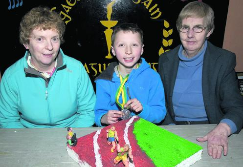Andrew Moynihan, representing Castleisland, pictured with his medal from the Kerry Community Games Model Making Competition in Castleisland on Sunday. Andrew is pictured with Kerry Community Games administrators, Patsi O'Connell (left) and Margaret Culloty. Photo by John Reidy