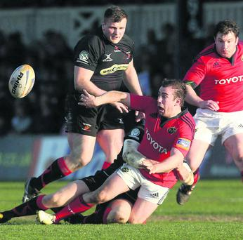 JJ Hanrahan, Munster, is tackled by Aaron Coundley, Dragons.