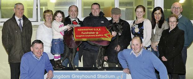 Sponsor Tommy Clifford and his daughter Katie present the winning trophy to Seamus Stack and his father Michael from Listowel after Highway Jedi won the Ardfert Potatoes Sweepstake Final all part of the Newmarket GAA Benefit night at the Kingdom Greyhound Stadium on Saturday. Included, from left, are members of the Newmarket GAA Committee Dan O'Riordan, chairman, Eileen Lane, Eilis Hourigan, PRO, Liz O'Sullivan, secretary, John Murphy, PRO, Noreen Sheahan, organiser, and, in front left, Willie O'Keeffe, and Barry O'Leary, asst secretary. Photo by www.deniswalshphotography.com