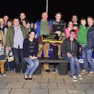 John Hickson representing the Hickson family presents the winner's trophy to winning owner Paddy O'Callaghan after Clonkil Con trained by John Kelliher won the Bobby Hickson Memorial Final at the Lispole GAA Night at the Kingdom Greyhound Stadium on Friday night. Included in the photo are the many members of the Hickson family connections to the winning owner, Declan Dowling, KGS Sales & Operations Manager and Seamus Griffin, chairman of Lispole GAA Club