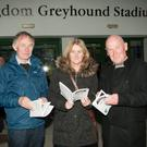 Mike and Regina Prendiville and Eugene Devane, all from Lispole, checking the form of the greyhounds at the Kingdom Greyhound Stadium,Tralee on Good Friday night