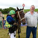 Ross Sugrue from Tralee rode Whistler to win the Mary Ann Molone Memorial Plate. Also pictured is his dad, Raymond