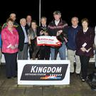 Winning owner Willie Purtill accepts the winning trophy from Christy Moynihan Representing the Sponsors after Punjabie Kitchen won the Munster Joinery Sweepstake final, all part of the Rathmore Parish Churches Fundraising night at the Kingdom Greyhound Stadium. Included in photo from left, Tom Hegarty, Maureen Cremin, Fr. Pat O`Donnell, Dan O`Connor, Kieran Casey, KGS, Racing Manager, Betty Moynihan, Pat Lyons, Kathleen Kelliher and Oliver Healy