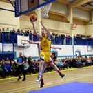 Conor Flynn, Keanes SuperValu Killorglin, scoring a basket against Fr Matthews Cork's Paul O'Driscoll in the National League in the Killorglin Sports and Lesiure Centre, Killorglin on Saturday