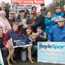 Noel Browne and Mark Lowther accepting the BoyleSports Derby trophy from John Boyle after Coolavanny Bingo won the BoyleSports Derby at the National Coursing Meeting in Clonmel