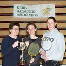 The Peggy Horan Perpetual Cup being presented by Peggy Horan to winner of the Division 2 singles championships Catherine Murphy (Kingdom), along with runner-up Sinead Galvin (Killarney) at the Kerry Division 2 Ladies Singles Badminton Championships last Friday at Killarney Sports & Leisure Centre