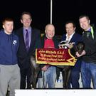 Special guest Marty Morrissey presents the winning trophy to trainer Neilus O'Connell on behalf of the owner after Tullycanna Nidge won the John Mitchels GAA Final at the Marty Party at the Dogs in the Kingdom Greyhound Stadium on Saturday. Included in the photo, from left, are Alan O'Donoghue, John Mitchels GAA Club, Declan Dowling, KGS Sales & Operations Manager, and Ciarán O'Brien, John Mitchels GAA Club. Photo by www.deniswalshphotography.com