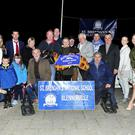 Shane O'Neill presents the winning trophy on behalf of his son Conor (main Sponsor), to Josephine O'Connor (joint owner) after Saleen Dream won the Powerworx Buster Sweepstake Final, all part of the St Brendan's NS, Blennerville Benefit night at the Kingdom Greyhound Stadium on Saturday night. Included are trainer Patrick O'Connor, joint-owner Kieran Culhane, Fr Francis Nolan, Louise Brassil (vice-principal), Maura O'Donnell (chairperson of the Parents Association) and those with connections to the winners and the school. Photo: www.deniswalshphotography.com