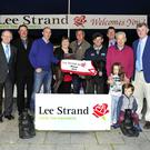 Lee Strand chairman Donal Pierse presents the winner's trophy to owners Shelia and Jeremiah Murphy, from Rathmore, after Russmur Flyer won the Lee Strand 550 Final at the Kingdom Greyhound Stadium on Saturday. Included from left are Lee Strand General John O'Sullican, Kieran Casey, KGS Racing Manager, Moss Leen, Declan Dowling, KGS General Manager, Maurice O'Connor, winning trainer, Billy O'Dwyer, I.G.B, with Milly and Moss Hughes. Photo by www.deniswalshphotography.com