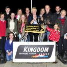 Mary Kennedy, centre, representing the Kennedy family, presents the winner's trophy to winning owner John Geoghegan after Slippy Maska won the Steve Kennedy Memorial Final at the Kingdom Greyhound Stadium on Friday. Included from left are Joe Carey, Declan Dowling (KGS Manager), Cathy Collins, Sara Coffey, Liam McAuliffe, Maggie Collins, Jackie Coffey, Aoibhinn Coffey, Kieran Coffey, Laura Kennedy, Kieran Kennedy, Michael Enright, Tom Collins, Eilish Geoghegan and Lucy Ahern. Photo by www.deniswalshphotography.com